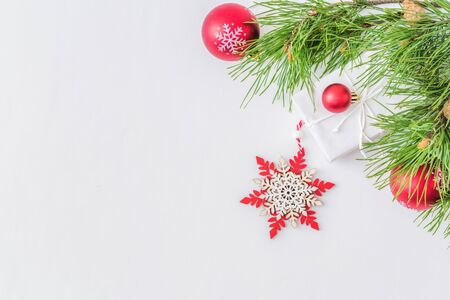 Holiday background with christmas branches and decoration on a light background Imagens