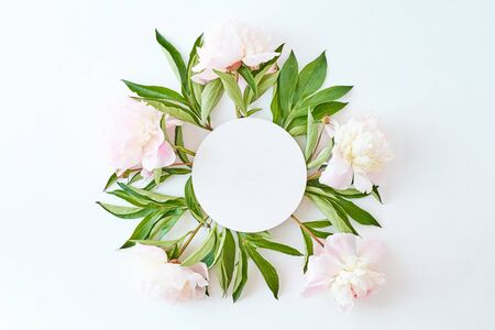 Mockup round white frame with light pink peonies on a white background