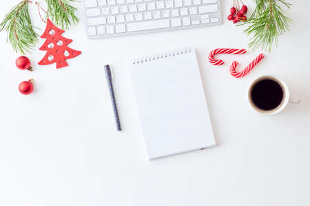 Mockup white notebook with pine branches and keyboard, christmas decorations on a white background