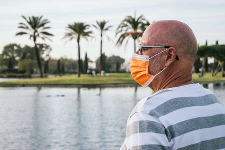 Portrait of a 65 years old mann looking to the horizon