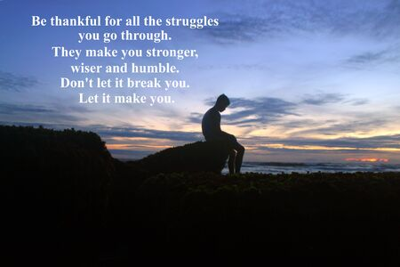 Inspirational motivational quote - Be thankful for all the struggles you go trough. They make you stronger, wiser and humble. Do not let it break you. Let it make you. With blurry image of young boy silhouette sits alone in solitude. Dramatic gloomy moody sky colors and rocky beach backgrounds.