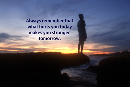 Inspirational motivational quote - Always remember that what hurts you today makes you stronger tomorrow. With blurry image of young boy silhouette stands alone on sea rock. Beautiful dramatic sunset sky colors and the rocky beach backgrounds. 写真素材