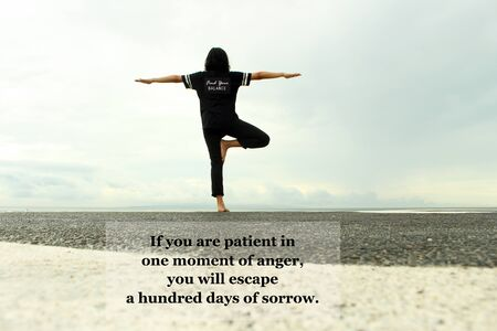 Inspirational quote - If you are patient in one moment of anger, you will escape a hundred days of sorrow. with tree yoga pose of a young woman against the ocean and blue sky view background. Buddha words of wisdom concept.