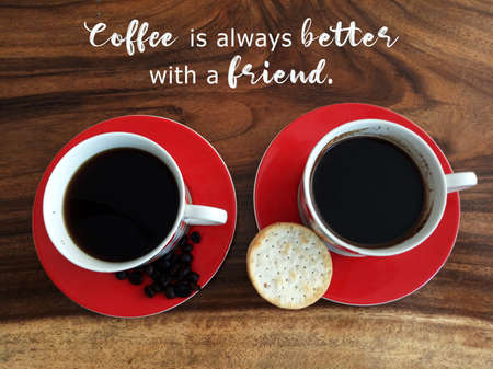 Inspirational motivational quote - Coffee is always better with a friend. On background of two cups of black coffee, cookies, raw coffee beans on wooden table. Morning coffee and friendship concept. Standard-Bild