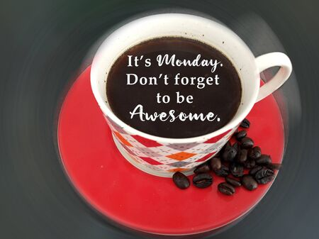 Monday inspirational quote - It is Monday. Do not forget to be awesome. On dark background of a cup of hot black coffee closeup, top view. Happy Monday concept with coffee and text message on it. Banco de Imagens