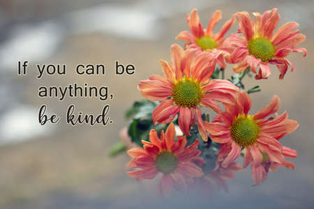 Kindness inspirational words - If you can be anything, be kind. Motivational quote concept with bouquet of peach dahlia flowers blossom on soft bokeh light background.