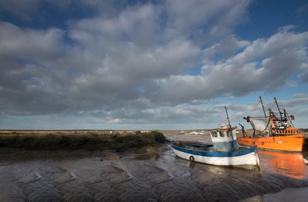 Blue & Orange Boats at Low Tide, at Burnham, Norfolk