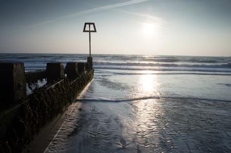 ornage: Sunrise at Swanage, Dorset Stock Photo