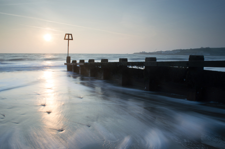 Sun coming up at Swanage in Dorset
