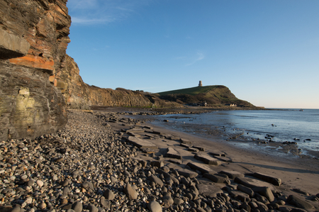 kimmeridge bay: Clavell Tower as the sun is setting, Dorset, England Stock Photo