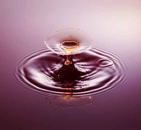 collide: Water drop photography, one or two drops of water dropped from height into water and captured as they hit the water or collide with each other.