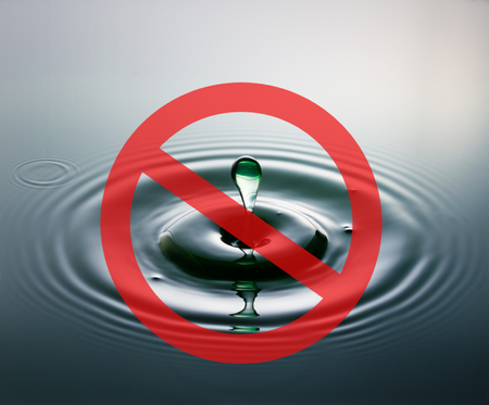 no access: A drop of water plopping into water with a red circle and diagonal line across, representing a no access traffic sign, to indicate no access to water.