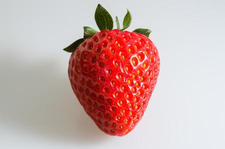 Strawberry - A single strawberry on a white backgtround