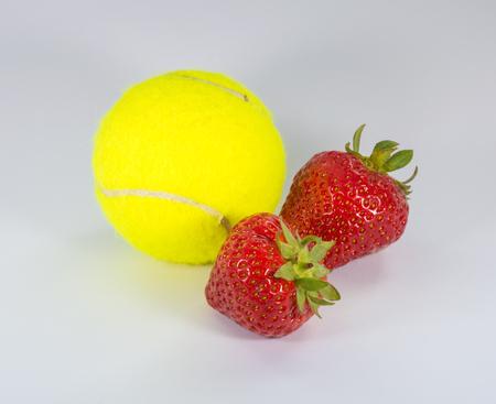 wimbledon: Wimbledon - Tennis Ball and Strawberries Stock Photo
