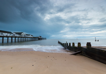 groynes: Southwold Pier,  Suffolk, on a cloudy morning at sunrise Stock Photo