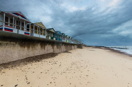 groynes: Close up of a line of beach huts at southwold Pier in Suffolk