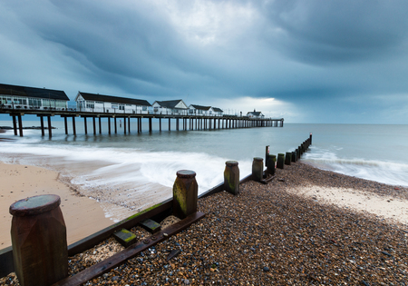 groynes: The Pier at Southwold at sunrise on a cloudy morning