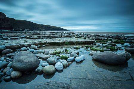 Pebbles on the beach at Dunraven Bay, Glamorgan Coast, Wales Stock Photo