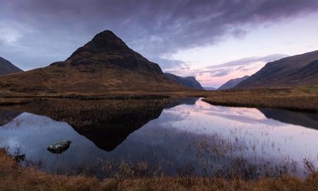 Mountain reflecting in water near Ballachulish, Glencoe, Scotland Stock fotó