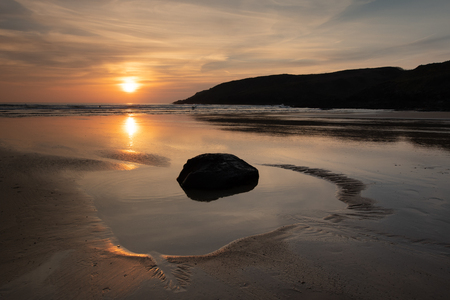 Angle Bay, Pembrokeshire, with pools of water as the sun goes down