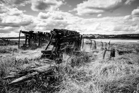 Wreck of a ship beached on the shore at Purton, Gloucestershire, to help stop the erosion of the shore.