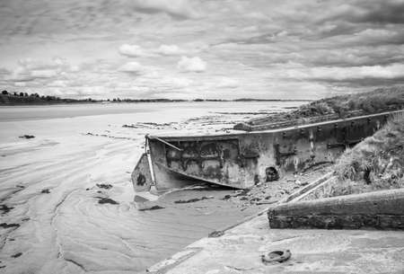 Wreck of a ship beached on the shore at Purton, Gloucestershire, to help stop the erosion of the shore. Reklamní fotografie
