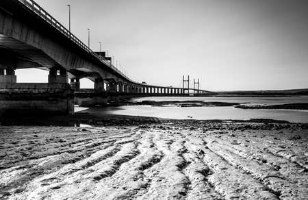 Prince of Wales Bridge, Severn Beach, seen from the beach with the tide out showing the ripples in the mud
