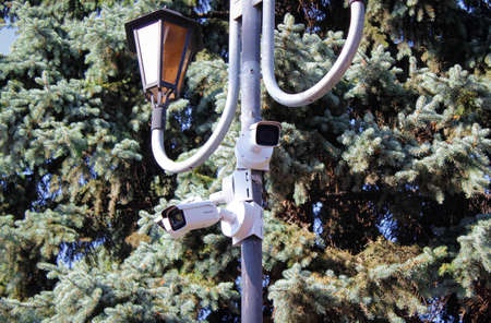 Chelyabinsk, Russia-July 05, 2020: a security camera is mounted on a pole In a Park. Selective focus.