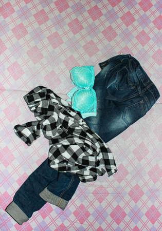 Different Women's clothing is lying on the bed. Undress on the move. Archivio Fotografico