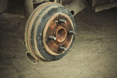 Wheel hub of the car in the tire shop. Replacement and repair of the machine disk. Auto repair.