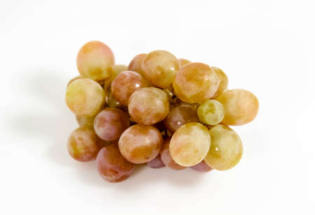 A bunch of grapes in close-up on a white background. Selective focus.
