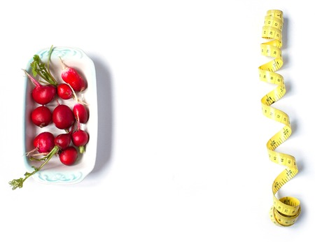 centimeter: radishes and centimeter on white background. Stock Photo