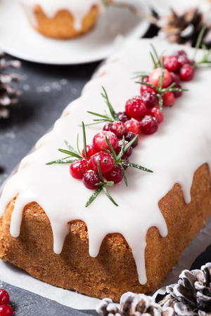 christmas cake with sugar icing cranberries and rosemary stock photo 91304652