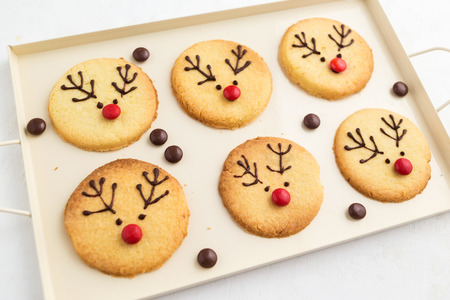 Homemade reindeer cookies decorated chocolate and red candies