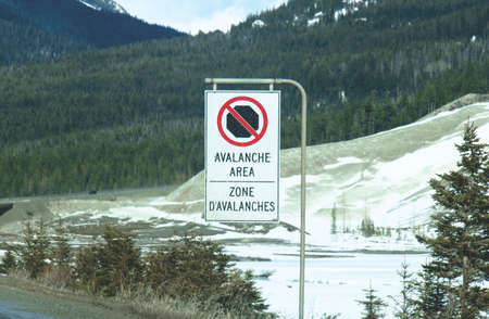 Avalanche Area sign on Trans-Canada Highway in British Columbia near Kamloops 스톡 콘텐츠