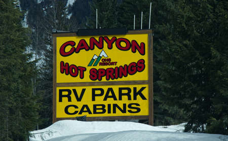 British Columbia, Canada - April 20, 2020: View of sign Canyon Hot Springs RV Park on Trans-Canada Highway