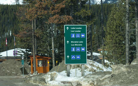 View of road sign with directional arrows point to