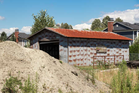 Port Coquitlam, Canada - July 13,2020: Sign attached to the last barn standing on Robert William