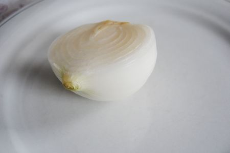 white onion cut in half on a serving plate