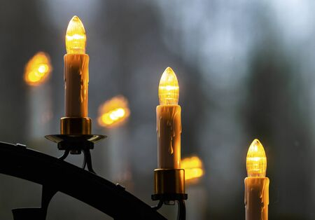 3 electric Advent candles conjure atmospheric light