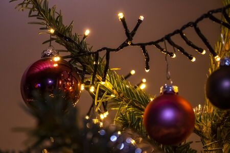 atmospheric, colorful Christmas decoration with fairy lights and shiny Christmas balls 写真素材