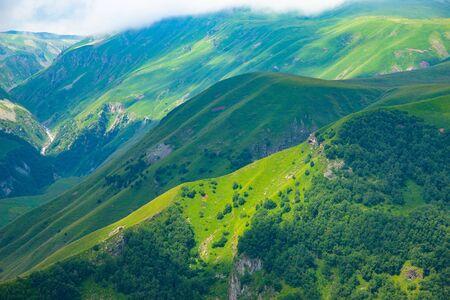 Beautiful mountainous area of Georgia. Summer landscape. Green grassy mountains