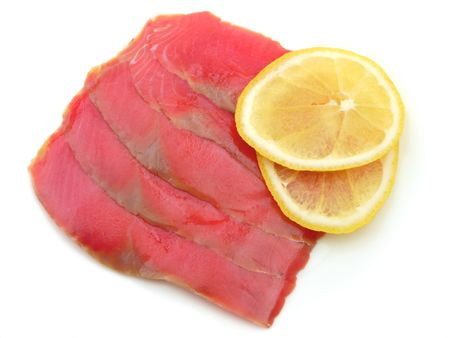 Fillet of red fish with lemon slices on white background Stock Photo - 6237858