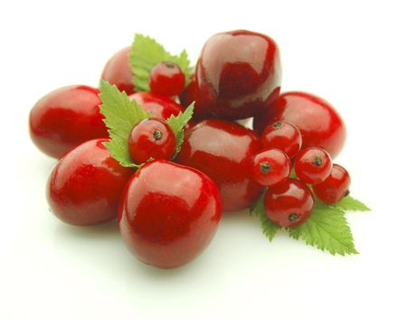 Ripe sweet cherry and currant with leaves on white background Stock Photo - 7345907