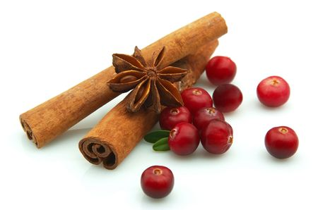 Fragrant spices of an anise and cinnamon with cranberry berries Stock Photo