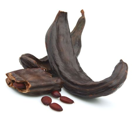 diuretic: Carob pods and seed on a white background