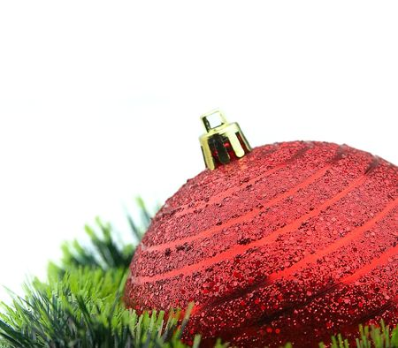 Christmas red ball and tinsel close up Stock Photo