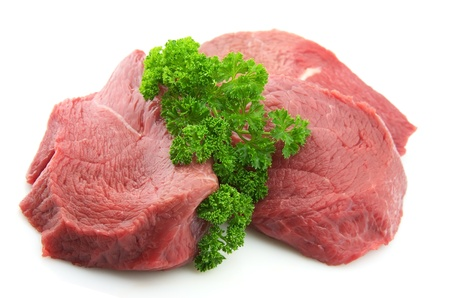 meaty: Pieces of crude meat with parsley and fennel Stock Photo