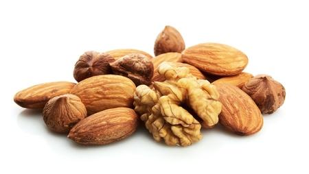 filbert: Walnut, filbert and almonds on a white background