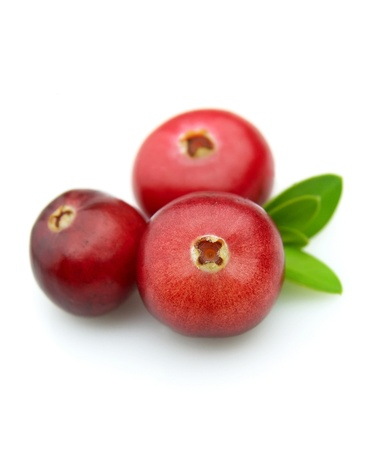 Three berries of a cranberry on a white background